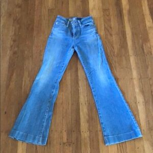 medium wash flare jeans with gemmed bottoms